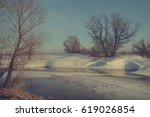 the melting snow in the early... | Shutterstock . vector #619026854