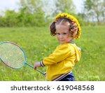 little girl playing badminton... | Shutterstock . vector #619048568