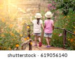 back view of two little girls... | Shutterstock . vector #619056140