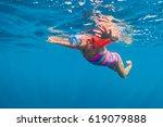 happy baby girl in snorkeling... | Shutterstock . vector #619079888