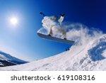 snowboarder jumping through air ... | Shutterstock . vector #619108316