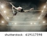 athlete in action of high jump. | Shutterstock . vector #619117598