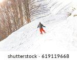skier skiing downhill in high...   Shutterstock . vector #619119668