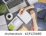 top view of girl's hand writing ... | Shutterstock . vector #619125680