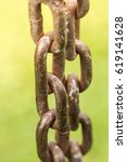 Close Up On Two Rusty Chains