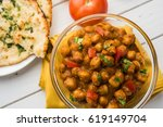 spicy chick peas curry or chola ... | Shutterstock . vector #619149704