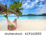 relaxing woman in a hammock on... | Shutterstock . vector #619162850