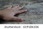 left hand on wood | Shutterstock . vector #619186106