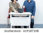 male and female consulting | Shutterstock . vector #619187108