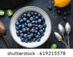 blueberries and vintage spoons  ... | Shutterstock . vector #619215578
