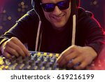 happy disc jockey at turntable  ... | Shutterstock . vector #619216199