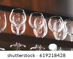 clear glasses on the dark... | Shutterstock . vector #619218428