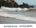wild winter waves on a beach... | Shutterstock . vector #619224890