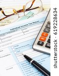 tax form with calculator  pen ... | Shutterstock . vector #619228634