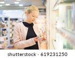 elegant blond young woman... | Shutterstock . vector #619231250