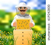 beekeeper on apiary. a man in a ... | Shutterstock .eps vector #619242830