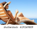 woman in hat relaxing at the... | Shutterstock . vector #619269809