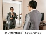 young asian businessman getting ...   Shutterstock . vector #619270418