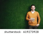 attractive man standing over a... | Shutterstock . vector #619273928