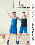 two basketball players enjoying ...   Shutterstock . vector #619276700