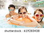 happy family playing in... | Shutterstock . vector #619283438