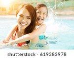 happy mother and daughter... | Shutterstock . vector #619283978