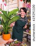 portrait of glad female florist ... | Shutterstock . vector #619291100