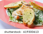 caesar salad plate with cheese... | Shutterstock . vector #619300613