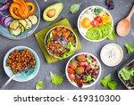 mixed healthy vegetarian salads ... | Shutterstock . vector #619310300