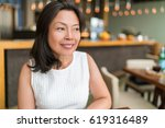 happy healthy asian middle aged ... | Shutterstock . vector #619316489