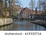 lakes and trees in brugge ... | Shutterstock . vector #619320716