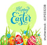 bright easter eggs on a grass.... | Shutterstock .eps vector #619333238