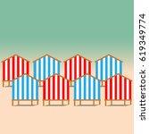 Beach Huts On The Seacoast As...