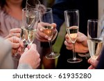 Celebration. Hands holding glasses of champagne. - stock photo