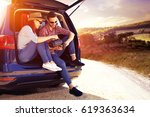 car trip and two lovers  | Shutterstock . vector #619363634