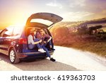 car trip and two lovers  | Shutterstock . vector #619363703