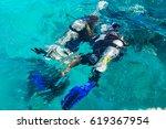 a scuba diving student have a... | Shutterstock . vector #619367954