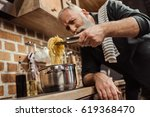bearded senior man cooking... | Shutterstock . vector #619368470