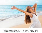 freedom woman on beach enjoying ... | Shutterstock . vector #619370714