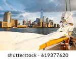 sailboat and a beautiful view... | Shutterstock . vector #619377620