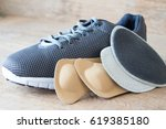 gray running shoes with... | Shutterstock . vector #619385180