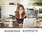 close up shot of a smiling cafe ... | Shutterstock . vector #619393274