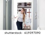 young delighted woman with... | Shutterstock . vector #619397090