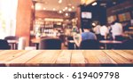 wood table top with blur coffee ... | Shutterstock . vector #619409798