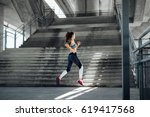 woman running in urban... | Shutterstock . vector #619417568