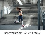 woman running in urban... | Shutterstock . vector #619417589