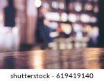 wooden table in modern loft... | Shutterstock . vector #619419140
