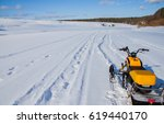 snowmobile in winter on the... | Shutterstock . vector #619440170