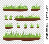 tufts of grass with earth on a...