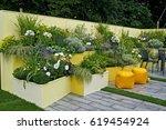 a colourful courtyard garden... | Shutterstock . vector #619454924